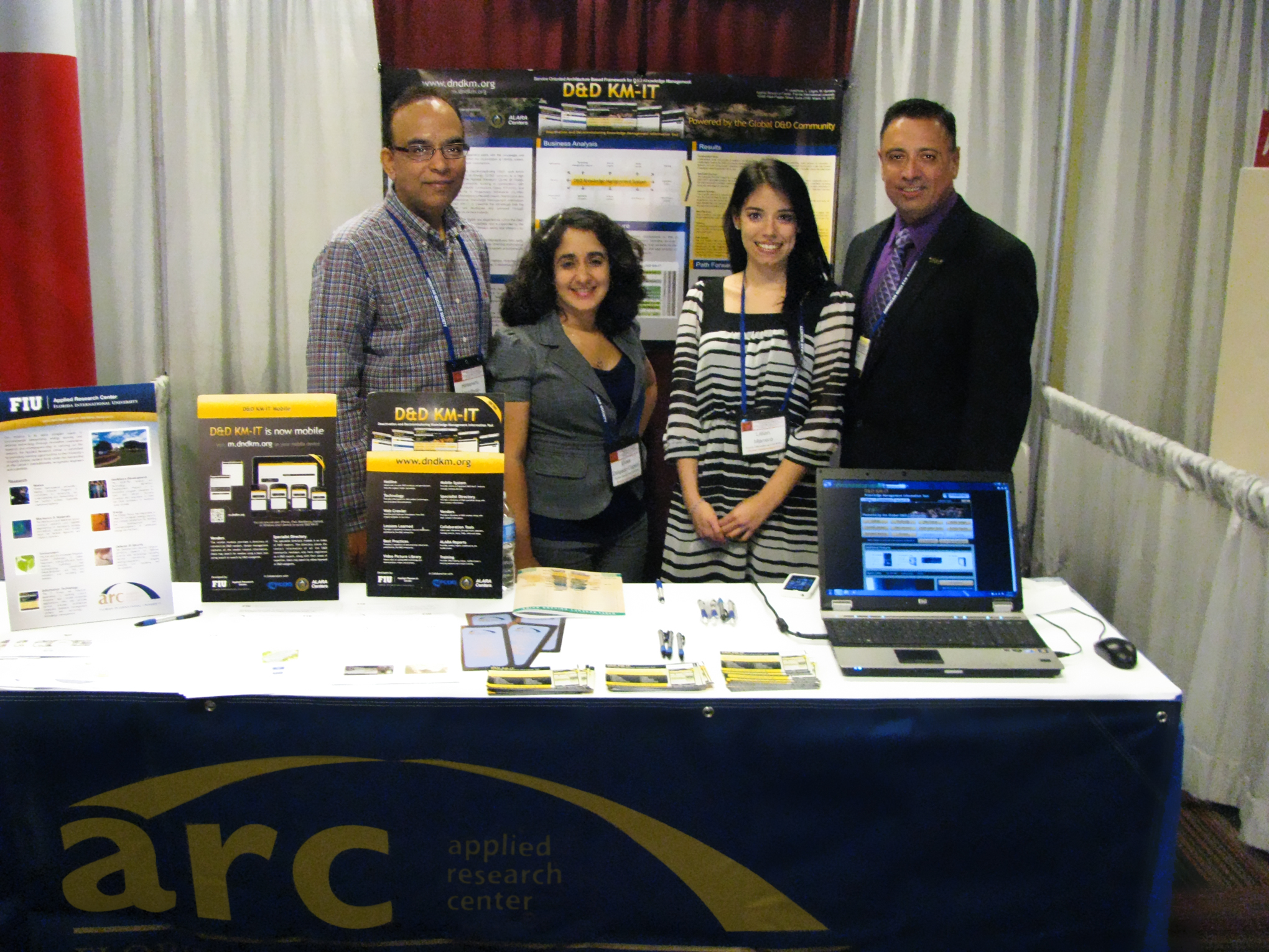 ARC Booth at DD&R 2012. From left, Himanshu Upadhyay, DOE Fellows (Elicek Delgado-Cepero and Lilian Marrero) and Program Director, Dr. Leonel Lagos
