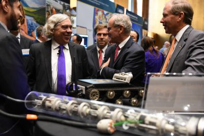 From left to right: Moniz, Risch and Peters tour the exhibits
