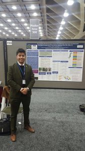 DOE Fellow Juan Morales presents a research poster at the Society of Toxicology Expo.