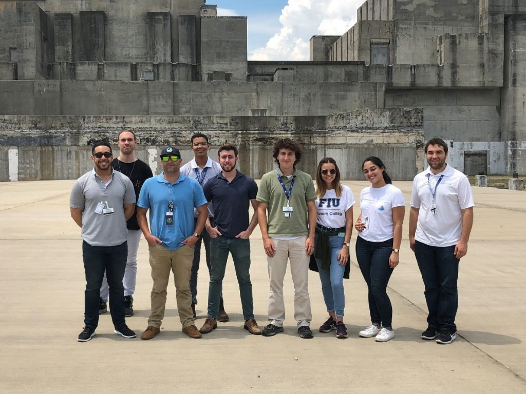 FIU, UT-Austin and University of Puerto Rico student interns in front of the SRS P-Reactor