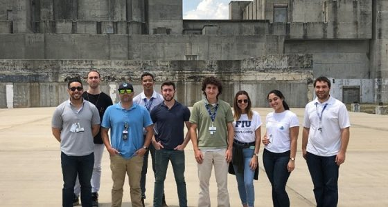EM Technology Development Office Program and Project Manager Jean Pabón, front row, second from left, joins student interns from FIU, UT, and UPRM in front of the Savannah River Site's P Reactor.