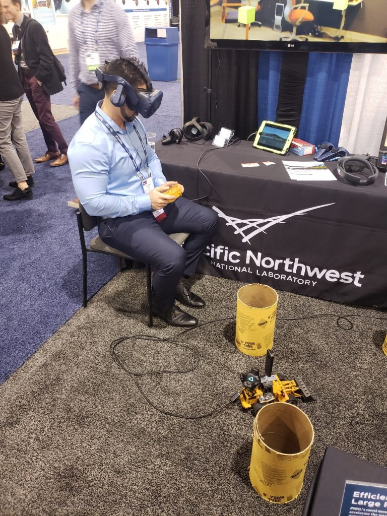 Roger Boza immersed in a virtual environment driving a bulldozer evading obstacles.