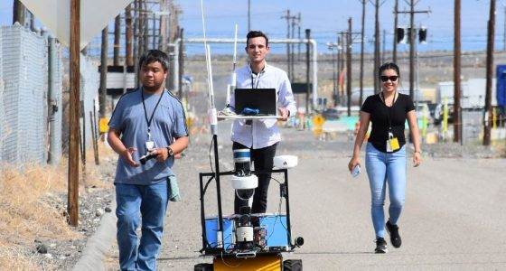 During a recent road closure, Florida International University students (left to right) Jeff Natividad, Joel Adams and Thi Tran test a radiation mapping robot outside of U Farm